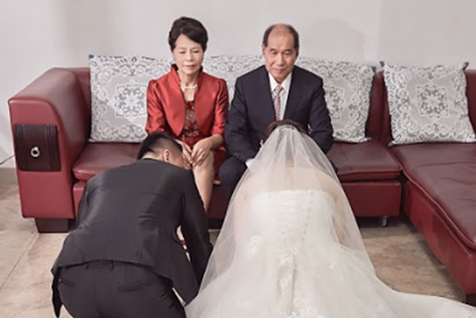 Kneeling Down to the Bride's Parents